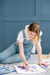 art inspiration masterpiece creation. painter at work. young beautiful girl drawing