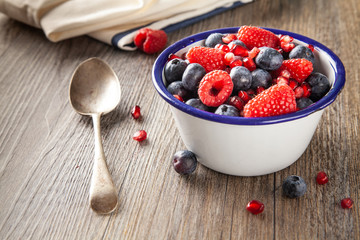 Selection of Forest fruits in a bowl with a spoon
