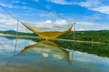 River scenery with wooden boat and fishing net in Phu Yen province, Vietnam