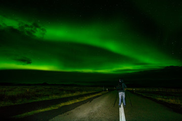 Amazing Northern Lights over the Iceland sky. The bright dancing lights of the Aurora Borealis. Green light in beautiful nightscape.