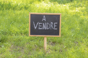 "Board with text in french ""For sale"""