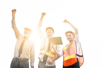 Group of male and female engineers celebration success happiness with raised hands at construction site. Teamwork and success concepts. Isolated on white background