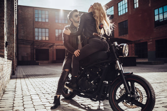 Romantic couple with motorcycle