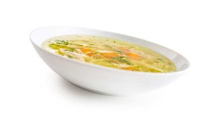 Chocken or beef soup with noodles carrot and parsley herb isolated on white