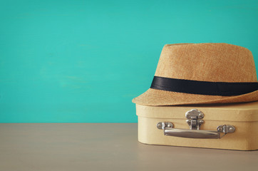 Image of old box and male fedora hat over wooden table. Father's day concept.