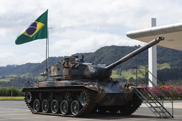 Brazilian battle tank, with the flag of Brazil, on display for people to know