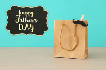 Image of shopping bag, present for dad. Father's day concept.