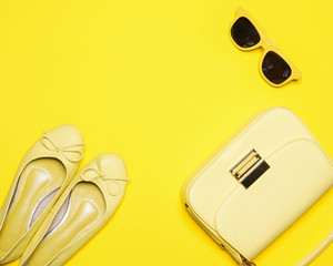 Trendy fashion yellow styled woman,  Accessories collection on yellow background, Summer concept, Flat lay, Top view