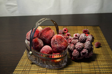 frozen strawberry with raspberries in a glass