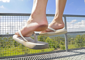Foot relaxing with Green Background and griddle fence