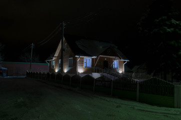 house with lights at night in winter