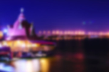 Beautiful blurred night Dnipro city view. Dark bue sky, river and building with lights or illuminations background. Vector illustration EPS 10