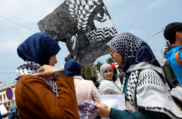 Pro-Palestinian protesters participate in a protest organized by Al Adl wal Ihsane in Casablanca
