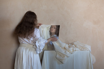 woman looking into mirror and hiding her face