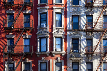 Fototapete - New York City style architecture background with windows and fire escapes