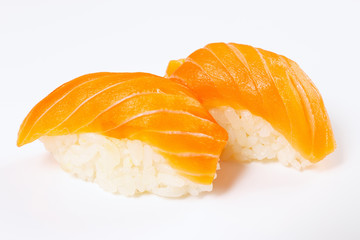 Classic sushi with salmon on a white background close up.