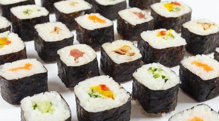 Assorted japanese sushi on a white background close up.