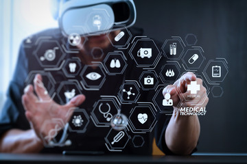 businessman wearing virtual reality goggles in modern office with mobile phone using with VR headset
