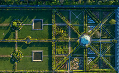 Aerial, vertical view on  exceptional geometric and symmetrical reneissance garden, clipped hedges with floral ornaments based on symetry and perspective.