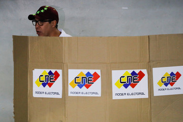 Venezuelan presidential candidate Henri Falcon of the Avanzada Progresista party, prepares to cast his vote at a polling station, during the presidential election in Barquisimeto