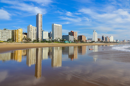 """Reflection of Durban """"Golden Mile"""" beachfront in the Indian Ocean, KwaZulu-Natal province of South Africa"""