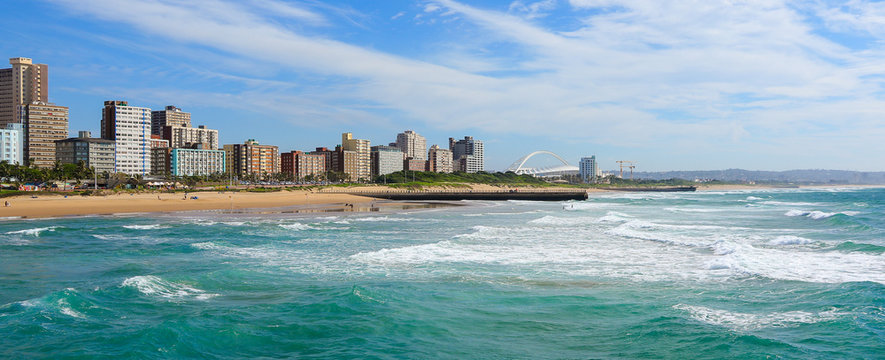 """Panoramic view of Durban's """"Golden Mile"""" beachfront as seen from from the Indian Ocean with waves, KwaZulu-Natal province of South Africa"""