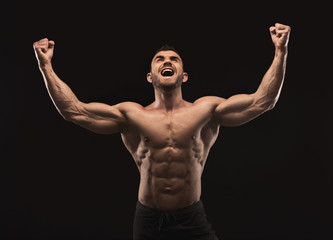 Strong athletic man showes naked muscular body Wall mural