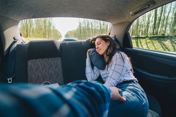 woman at car backseats sleeping. car travel concept