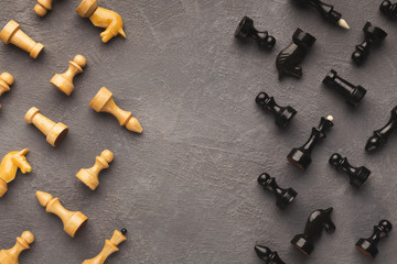 Chess figures on gray table background