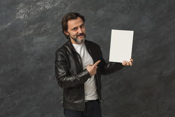 Confident man with blank white board