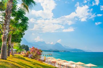 Beautiful beach with green trees in Kemer, Turkey.