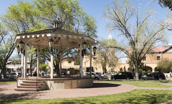 Gazebo in Old Town Albuquerque Plaza, and San Felipe de Niri Church. Old Town Albuquerque, New Mexico, USA.