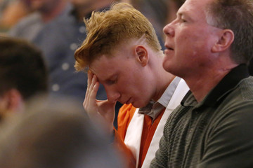A graduating senior from Alvin High School reacts during prayer services at the Arcadia First Baptist Church in Santa Fe