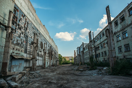 Apocalyptic concept, abandoned city background, ruined buildings, decay constructions after disaster or war
