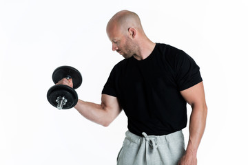Athletic body builder pumping up muscles with dumbbells on white background
