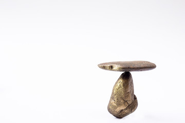 Balance different stone concepts together on a white background.