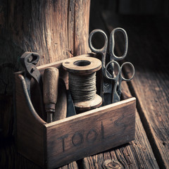 Retro small set of tools in a wooden workshop