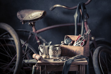 Old bike fix service with wheels, rubber patch and tools