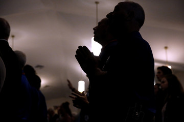 Members of the community attend a prayer service at the Arcadia First Baptist Church in Santa Fe