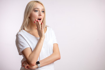 Pretty girl with blond hair is calling aloud for help. copyspace