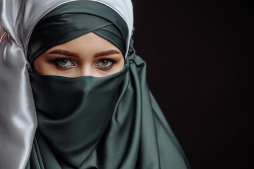 copy space. devout Muslim female.peaceful religion. Arabian woman with beautiful makeup
