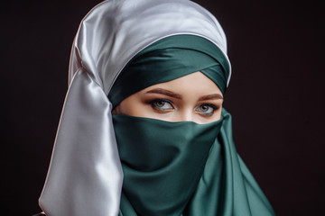 woman wearing Islamic outfit. humility idea. heavenly thoughts