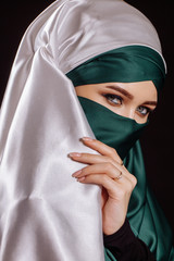 close up portrait . shy Muslim wife does't want to show her face