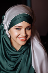 Caucasian smiling woman in hijab
