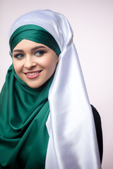 close up portrait of charming Muslim female in dress showing her modestry