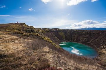 Visitors climbing around Kerid Crater Lake, Iceland