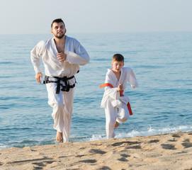 coach and pupil in a kimono run