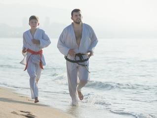 man and teenagerl in a kimono run