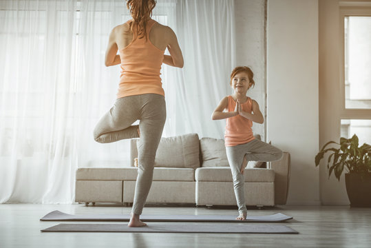 Mother and daughter exercising at home