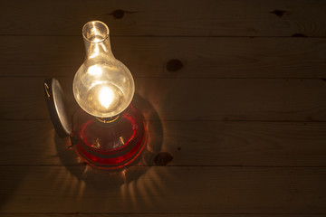 Old oil lamp on the wall